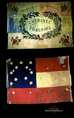 First National Confederate Flag  The flag dates to first months of the war. The reverse is embroidered with a wreath and the wordsCherokee Dragoons. The mottoEither with it or upon itis also present. This early war militia unit became part of the 'Phillips Legion' that served in Virginia.