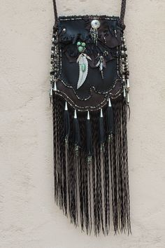 Feathers and Fringes. Made by Carole Hook for Jessie Western Portobello Rd. London.