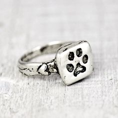 handcrafted dog paw ring