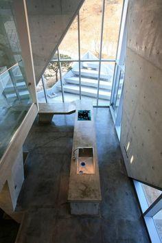 Bare Concrete Kitchen