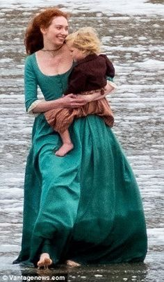 Eleanor Tomlinson as Demelza Poldark and baby Clowence in season 4 filming.