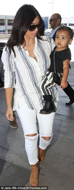 Supporting her man: The day before, Kim watched her husband headline Budweiser's Made In America Festival in downtown Los Angeles