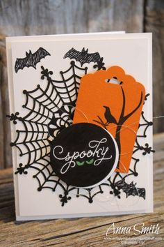 The spider web is a fun doily, along with Project Life Seasonal Snapshot stamps for the bats.  Throw in a spooky circle and a pop of orange for a great handmade halloween card.