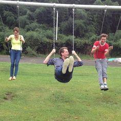 Shailene Woodley, John Green, & Ansel Elgort swinging on the set of tfios.