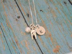 Dental Hygienist Necklace, Sterling Silver Custom Made Hand Stamped Dentist, Tooth, Teeth, Molar Dental Hygienist Initial and Pearl Necklace by EverythingInitials on Etsy https://www.etsy.com/listing/207297798/dental-hygienist-necklace-sterling