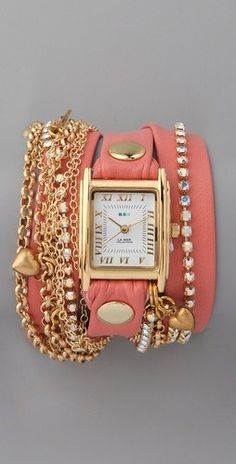 Super cool wide leather band watch with attached chains and bling.  Leather looks like either pink or maybe a salmon color.