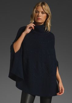 Poncho with leather