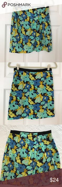 "JCrew Printed Asymmetrical Skirt in Size 0 This is a JCrew Factory asymmetrical skirt in a flower print of blues, greens, yellows and cream with a black grosgrain waistband. It sits above the waist and has a side zipper. It is 17"" in length. It is made of 100% silk and is lined in a black 100% polyester. It is in very good condition. J. Crew Skirts Asymmetrical"