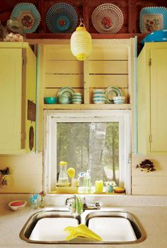 Yellow in a kitchen always makes me nostalgic. We had it in my first house as a child, and it's such a happy kitchen colour