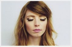 Instead of stopping at your eye's natural curve, you can extend and flick your liner to outline the entire outer corner of your crease to give a dramatic yet elegant look. First outline the basic triangular shape with a pencil liner then with a gel liner, go over the shape and clean the outer edges by carefully using an angled eyeliner brush.