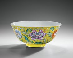 A YELLOW-GROUND FAMILLE ROSE BOWL, GUANGXU MARK AND PERIOD