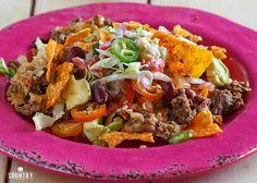 Dorito Taco Casserole recipe is layers of seasoned ground beef, doritos, kidney beans, shredded cheese, lettuce, tomato and catalina dressing!