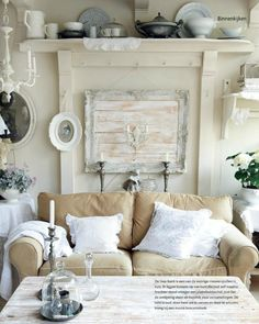 This is a pin for me to remember that khaki slip covered couches are a great alternative to the white I love. Because they look great with white accents;natural like white clouds floating over sandy beaches