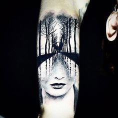 It is incredible how detailed the reflection of the trees is in this piece. Tattoo by Caroline Friedmann #InkedMagazine #face #tree #surrealism #art #tattoo #tattoos #Inked #Ink