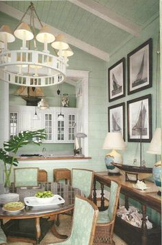 Sage colored walls, fabric and accents! Gorgeous coastal dining space!