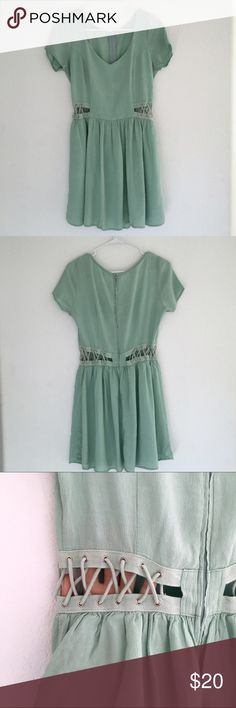 Detailed zip back skater dress from tobi Mint colored dress with cool criss cross detailing around the waist. Zips in the back and is fully lined. No size on the tag but I wore it when I was a M/L. Ask for measurements!! Reasonable offers considered! This was only worn once! Tobi Dresses Mini