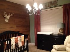 This is the final product of my dreamt up lodge, hunting, outdoor nursery for our little boy! My husband and I could not be prouder of it! I did it with out a touch of camouflage either!