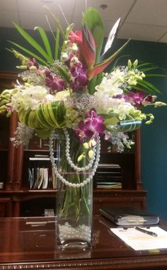Send the Classy Exotic Lady- Bird of Paradise & Dendrobium Orchids Arrangement bouquet of flowers from Orchids Little Secret Boutique in Placentia, CA. Local fresh flower delivery directly from the florist and never in a box! Tropical Flower Arrangements, Flower Arrangement Designs, Church Flower Arrangements, Orchid Arrangements, Beautiful Flower Arrangements, Beautiful Flowers, Home Flowers, Exotic Flowers, Tropical Flowers