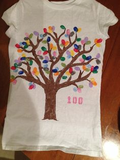 100 days of school shirt done with fabric paint. Used daughters thumbprints for the leaves.