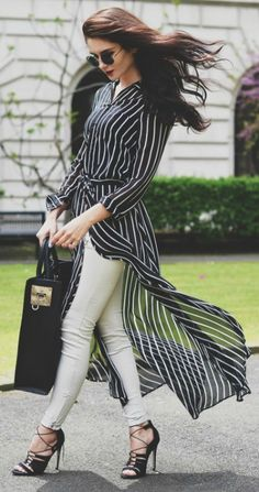 Lolita Masagutova + long over long trend + floaty striped longline shirt + effortlessly stylish ! + pale jeans + black stilettos  Longline Shirt/Shoes: ASOS, Trousers: ZARA, Bag: Sophie Hulme. Stylish Spring Outfits.