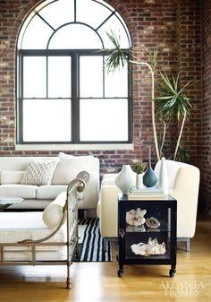 Brick Walls and arched windows. loft belongs to interior designer Elizabeth Hanson. via Atlanta Homes Interior Design Inspiration, Home Decor Inspiration, Home Living Room, Living Spaces, Style Loft, Loft Interiors, Urban Loft, Modern Loft, My Dream Home