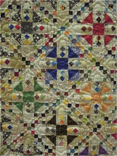 """""""OMG- A Million Tiny Pieces"""" by Joan McNamara, 2013 AZQG. Design by Sue Garman.  The nine patches that create the chains are 1-1/2"""" finished, as are the half square triangles. The little four patches on point are 1"""" finished."""