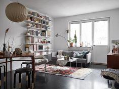 Scandinavian livng room with bookshelves