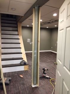 I start talking about the support pole, I want to mention a little project I did that I am super thrilled with. I knew I wanted to pu. Basement Remodel Diy, Basement Makeover, Basement Apartment, Basement Bedrooms, Basement Stairs, Basement Flooring, Basement Renovations, Home Remodeling, Basement Bathroom