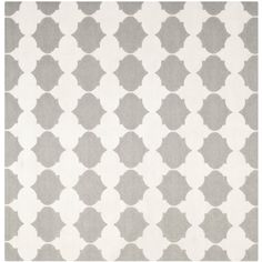 Morrocan inspired design and dense hand-woven wool pile highlight this handmade dhurrie rug.