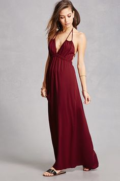 A woven maxi dress featuring a halter with braided self-ties, an elasticized back with a tie waist, dual on-seam pockets, and a flowing skirt.<p>- This is an independent brand and not a Forever 21 branded item.</p>