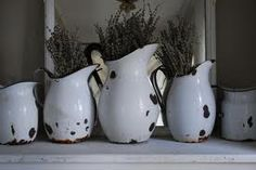 love the lavander in the old enamelware pitchers