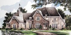 Steeply pitched roofs, classic shutters and stonework accent the Country French style of this executive home.