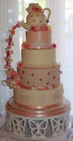 Wedding Cakes - 4 tier pouring teapot wedding cake with sugar flowers and hand painted details, inspired by a design by the artisan cake company. #pouringteapotcake #vintageweddingcakes #extravagantcakes