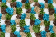 Joy Is At Home: DIY Pom Pom Rug & How To Make Giant Pom Pom's - Would be so cute for a kid's room!!