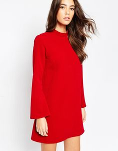 SUCH a gorgeous classic dress. The high neck, flared sleeves and that vivid red shade, perfect for teaming with chunky black accessories.