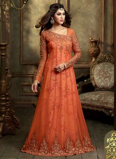 7411110897 Wrap on this tomato color embroidered net floor length Anarkali suit and  strike a thousand hearts with your haunting beauty. The lovely lace, patch,  ...
