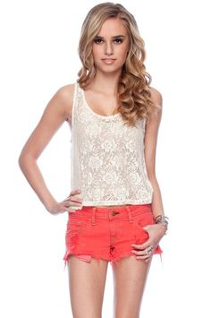 Love the feminine lace with the bright shorts
