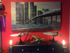 Some of the sci-fi stuff in my collection. Painting was a gift from my wife and inspired by blade runner :)