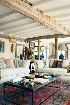 Wood & colourbond panelled ceiling? Comfy couches with lots of pillows. Big pictures on the wall.