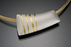 Bamboo Pillow by Tom McGurrin: Silver and Gold Necklace available at www.artfulhome.com