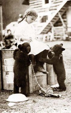 Girl with real pet bear cubs