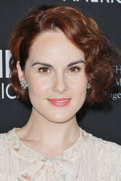 Michelle Dockery's wavy crop    DO play copycat with Michelle Dockery's stunning auburn wavy bob. We love this look on the Downton star.