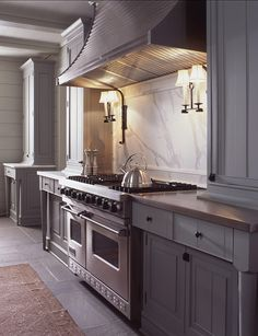 grey kitchen, cararrra marble backsplash, sconces above range Pursley Dixon Grey Kitchens, Luxury Kitchens, Home Kitchens, Grey Kitchen Cabinets, Kitchen Cabinet Design, White Cabinets, Kitchen Walls, Kitchen Paint, Kitchen Designs