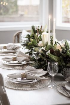 An elegant farmhouse holiday tablescape using fresh floral arrangements in a green and white neutral color palette with white and cream plates, candles, and napkins. Perfect for a simple and beautiful Christmas cottage table setting. - Rain and Pine Cottage Christmas, Farmhouse Christmas Decor, Farmhouse Decor, Farmhouse Design, Modern Farmhouse, Farmhouse Style, Flowers For You, Fresh Flowers, Elegant Flowers