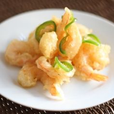 A lightly battered tempura shrimp that is paired with a drizzle of honey that has been infused with garlic, onion and spicy jalapenos.