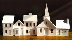 Christmas Village Townhouses by VillageSquare on Etsy, $19.95  Absolutely love this.  Bought for Christmas, but plan to turn it into a Halloween village.