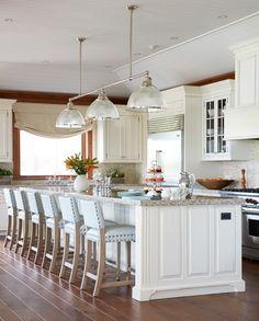 Kitchen with a large island, designed by Anne Hepfer, via @sarahsarna.
