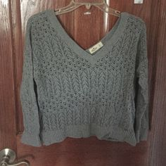 HOLLISTER V cut / off shoulder Sweater GREAT CONDITION! super cute off the shoulder grey sweater. Very light material but super comfortable ! No damages or wares. Maybe worn once. Hollister Sweaters V-Necks
