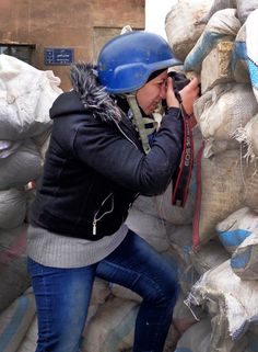 Noor Kelze, a 25-year-old from Aleppo, Syria, was teaching English at a private school when the uprising started two years ago. Since then, she has learned to be a war photographer and has been sending photos to the Reuters news agency. Link goes to great NPR article on her.