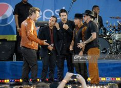 Nick Carter, Howie Dorough, Kevin Richardson, Brian Littrell and A.J. McLean of the Backstreet Boys perform on ABC's 'Good Morning America' at Rumsey Playfield, Central Park on August 31, 2012 in New York City.